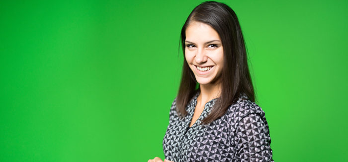 TV weather news reporter at work.News anchor presenting the world weather report.Television presenter recording in a green screen studio.Young woman with copy space on green screen chroma key; Shutterstock ID 332150684